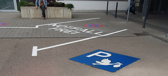 Parking lot with stork symbol for pregnant women
