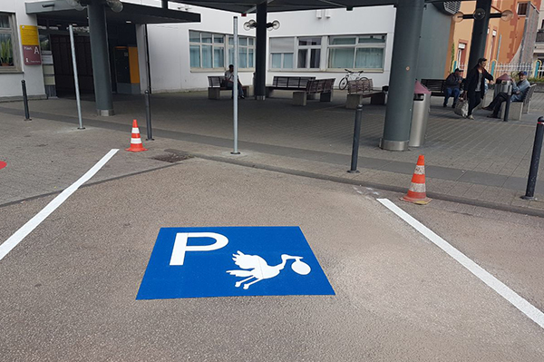 Parking space with a stork symbol for pregnant women