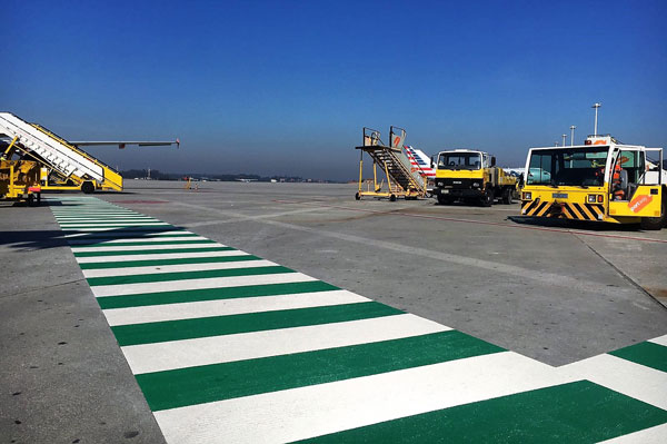 Green white crosswalk in Porto Airport