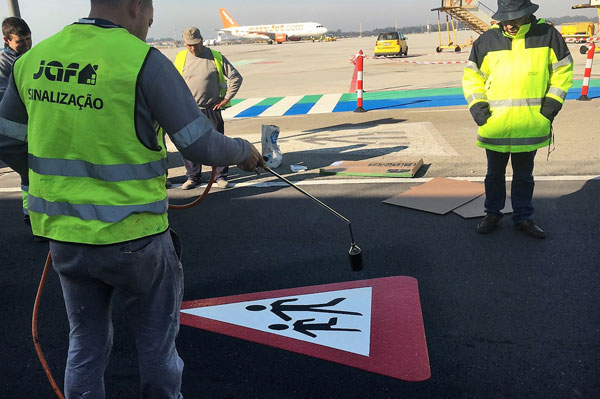 Easy application of durable road marking sign