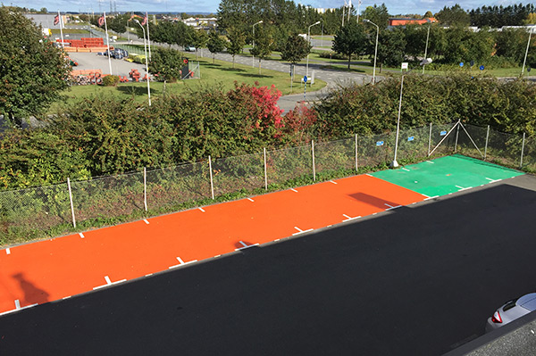 Orange and green parking spot markings